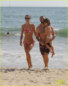 Alessandra Ambrosio and Jamie Mazur take their daughter Anja to the beach on September 1, 2013