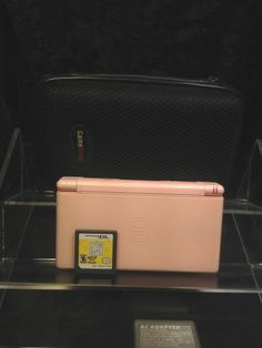 Nintendo DS Lite Coral Pink Handheld System w/ 1 Game and Case.The Biggest Loser