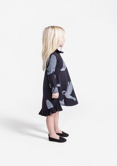 This Girls Dress with Neck Ruff and Back Hem Ruffle is everything you wanted in a dress for cooler weather: long sleeve, Snowy Owls print and unique details.