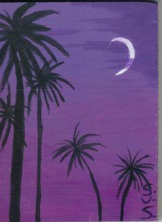 palm trees in a purple sky