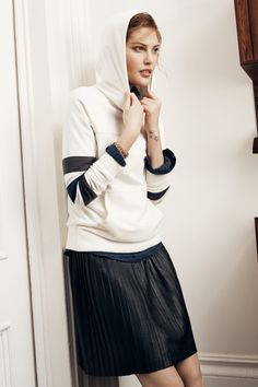 Madewell Home Game hoodie worn with the Leather Knife-Pleat skirt.