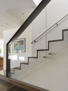 Glass interior railing with wood