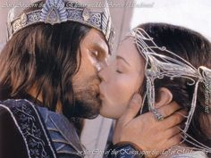 Aragorn and Arwen in The Lord of the Rings....love how he has his hand on her face like that...hot....