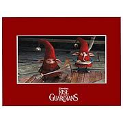 Rise of the Guardians Santa Dwarfs Laser Cel. Artwork straight out of Rise of the Guardians! Features an image of North's dwarfs. Don't miss out on owning a part of the movie! Measures 8-inches wide x 6-inches tall! Own a part of the Rise of the Guardians movie by Dreamworks! This Rise of the Guardians Santa Dwarfs Laser Cel features a funny image of North's little dwarf helpers, each in a ridiculous red outfit with musical instrument in hand. This delightful piece of artwork is a…