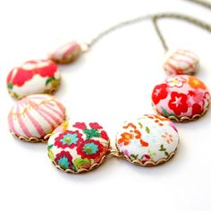 fabric covered buttons fashioned into a necklace.