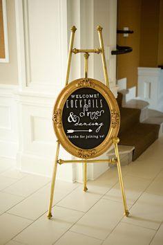Ornate gold frame chalkboard wedding sign.