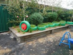 Have your very own Hungry Caterpillar in your garden that will help the plants instead of eating them! All you need is some paint and some tires!