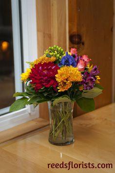 Pretty flowers brighten a quiet corner. Wedding Decorations, Table Decorations, Pretty Flowers, Glass Vase, Floral Design, Reception, Corner, Rustic, Home Decor