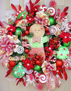 Festive red and green gingerbread candy cane swirl sweet ribbon bow flower arrangement wreath - great Christmas craft project!