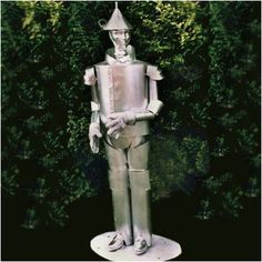 The Wizard of Oz was one of my favorite childhood movies, and this tin man sculpture brings back many warm memories. The man who went looking for his heart - only to find out he had the biggest one of all - makes a wonderful garden sculpture. Garden Tool Shed, Garden Tool Storage, Tin Man Costumes, Flower Landscape, Metal Garden Art, Concrete Pots, Cat Statue, Garden Statues, Garden Sculptures