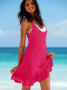 Your favorite tee, now in a dress: the Ruffle-hem Tee Dress from Victoria's Secret. Featuring an easy, dropped-waist shape and flirty ruffled hem, this racerback look is ready for off-duty fun. It also makes for a great cover-up.