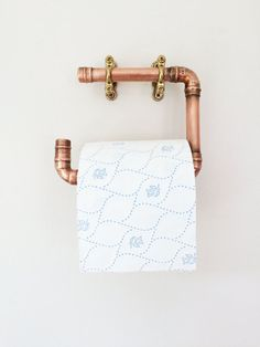 Modern copper loo roll holder made of copper pipe fittings. We hand solder and hand finish all of our copper goods to maintain a high standard of