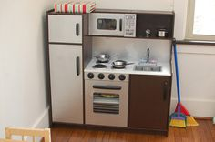 "kidkraft deluxe pastel toy kitchen makeover to ""stainless steel"""