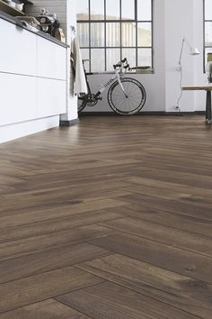 Kronotex Herringbone 4766 Calais Oak on tulevan kalanruotolaminaattimallistomme kolmas ja tummin kuosi. Laminaatti on käyttöluokkaa 32 ja 8mm:n runko on kosteussuojattu. Todella tyylikäs laminaatti. Valitettavasti saamme ensimmäisen erän varastoon vasta huhtikuun lopulla, joten vielä joutuu hieman odottelemaan. Hardwood Floors, Flooring, Studio, Amazon, Vintage, Wood Floor Tiles, Wood Flooring, Amazons, Riding Habit