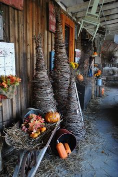Olde Mill Primitives; primitive lighted grapevine twig trees for the front porch. Swap out lights for the seasons ie. orange for fall, white for winter.