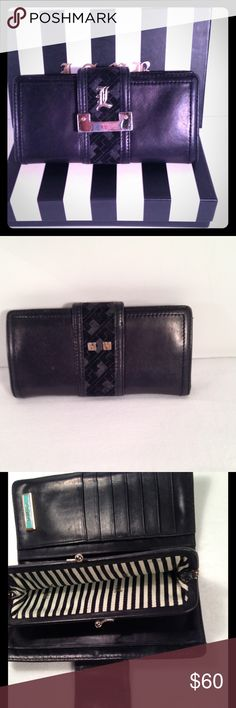 L.A.M.B. Black Clutch Wallet❤️ Classic black clutch wallet designed by Gwen Stefani. Good pre-owned condition with some wear and some scratches on hardware. Genuine leather. Goldtone hardware. Interior kisslock coin holder & many cardholders for organization. Authentic & smokefree. Box not included. Please see all photos and ask any questions prior to purchase.💋 L.A.M.B. Bags Wallets