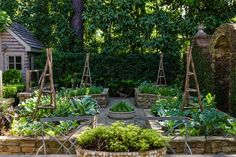 Beautifully designed small vegetable garden with raised beds of stone
