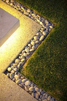 Pebbles and exposed aggregate concrete (less maintenance than pebbles)