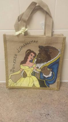 Hand painted beauty and the beast design jute bag all ready for your little princess  Can paint these bags with your childs favourite Disney character, feel free to message any request! When buying just simply include a message with name required
