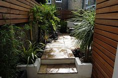 A tight courtyard with contemporary privacy screen/fencing. Might be a nice look on a side yard.