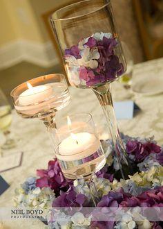 Floating candle centerpieces. Blue & purple hydrangea wedding reception flower centerpieces.