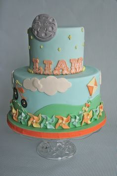I was given the color palette of pale blue, orange, yellow & green as well as the theme of vintage childhood elements for this cake.  I ...