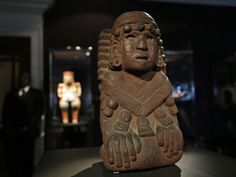 An Aztec stone, Chalchihuitlicue, goddess of water basalt sculpture from Mexico, is seen at Sotheby's auction house showroom in central London, Monday, Feb. 11, 2013. The pre-Columbian artifact is part of the Barbier-Mueller collection to be offered in the auction house Paris sale on March 22-23, 2013. Comprising around 300 works from Mexico, Central and South America this ensemble of pre-Hispanic art, comprises works in various media, including stone and wood sculptures, ceramics, textiles…