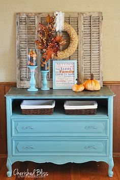 Love the wreath hanging from the shutters and the painted dresser and the baskets placed where the drawer was removed. (Fall decorating Ideas )