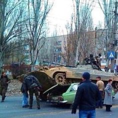 Andre Golo @AndreGoLow  ·  Nov 18  Think you're having a bad day? This guy had his car crushed by drunk Russians driving an APC.