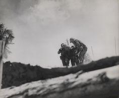 Injured US Marine being carried by fellow Marines Tarawa Gilbert Islands November 1943.