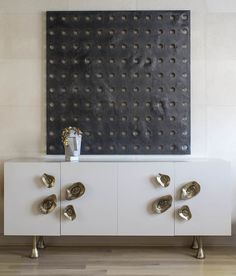 DARREN FRANKS   IDEALIST. Hand troweled plaster featuring Kelly's signature perforated detailing