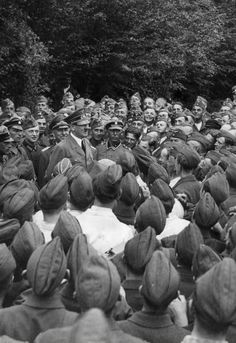 Adolf Hitler with soldiers, circa 1942. - National Socialism