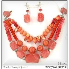 Necklace Set Multi Strand Lt. Coral accented w/silvertone beads WS0746RDCOR. You will love this Chic Multi Strand of Light Red Coral necklace accented with silver tone beads and very intricately designed.  This necklace includes a pair of matching dangle earrings.  Its just the right finishing touch to any outfit.  A perfect item for gift giving and will fit up to a 18 neck comfortably.