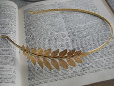 A crown of delicate golden leaves is the perfect Victorian-inspired accent. Wedding Headband by CreativeKates. $22.00.