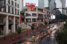 Pedestrians cross the street in front the EpiCenter on July 10, 2012 in Charlotte, North Carolina. The EpiCentre is a hub for dining, entertainment, recreation, and nightlife located in Uptown. Businesses and attractions in Charlotte are anticipating a boost in visitors when the city hosts the 2012 Democratic National Convention (DNC) September 3-6