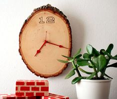 Cute and rustic #DIY wall clock. Love the red hands!