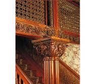 The woven willow screen over the stairs in the front hall.