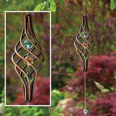 copper-finished Wind Spinner is a unique piece of outdoor decor for your lawn or garden. Sculpture rotates in the breeze. The twisted cage holds 3 iridescent marbles with 1 additional marble that swings from a metal chain. - See more at: http://www.bitsandpieces.com/product/wind_spinner/outdoor_living#sthash.e8GRV6se.dpuf