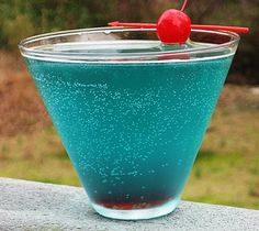 Shark Bite - tropical blue tainted with a few drops of grenadine (for the blood of course). Captain Morgan Spiced Rum, light rum, Blue Curacao, Sweet & Sour Mix, Sprite & grenadine