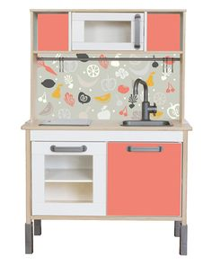 "The popular IKEA DUKTIG play kitchen is an absolute classic among all the children's kitchen models. With the sticker set ""FRUKTIG"" it gets an individual look. This make-over is very easy to make and quickly done for everybody. The sticker sets includes: - 1 sticker for the back board of the kitchen - 1 sticker for the front door and - 2 stickers for the back boards of the shelves IMPORTANT: You can either stick the big decal directly to the wall or you can stick the back board on a piece of…"