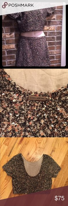 Billabong crop top and skirt set This is a set I'm selling for a friend who wore it once for 2 hours. Purchased at a high end boutique this is very well made. Beautiful sparkelicious sequins cover both top and bottom which are both fully lined. Both top and bottom are zip sides with very little stretch. See addtl pics for measurement. Billabong Dresses