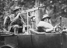 New York July 13, 1917. A couple has mounted a machine gun on their car and touring to show people how such a Home Defense Measure can be done if it becomes necessary.