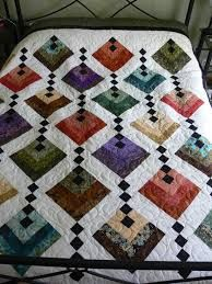 different way of looking at log cabin block...reminds me of dangling ornaments or a bead curtain...