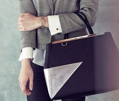 A structured leather tote is the ultimate commuting accessory.