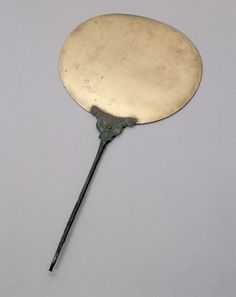 Bronze toiletry mirror, Egyptian, 800 BC-100 BC.