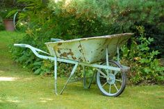 Old vintage wheelbarrow - I so want this! Love the colour.