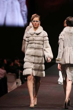 CADANO, Fall 2016 Fox, swakara, and mink in various shades of grey are chosen to represent the pureness and prosperity of Queen Elizabeth I –the inspiration of this collection. The varieties of long and short fur are tactfully applied to create big high collars, nipped-in waist and voluminous hip line or skirting in this range of dresses and coats which is the reminiscence of medieval period. Swarovski crystal embellishment further exemplifies their elegance and femininity.