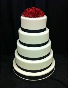White Wedding Cake with Black Ribbon and Red Roses