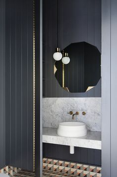 black panelling in bathroom with marble and brass by hecker guthrie