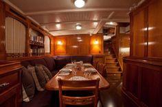 Salon Dining of Carl Linné sailing yacht for sale.